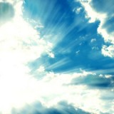 stock-photo-fantastic-sun-rays-are-striking-through-the-clouds-like-an-explosion