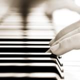 stock-photo-hands-over-piano-in-beautiful-sepia-tone