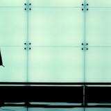 stock-photo-man-walking-through-an-airport-terminal_rev100