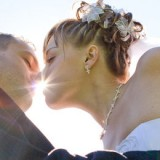 stock-photo-sun-shines-through-the-lips-of-the-kissing-couple