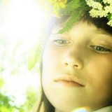 stock-photo-lovely-little-girl-in-flowers-wreath